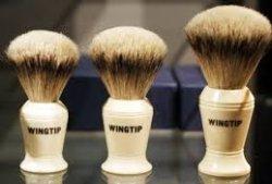 The Barbershop at Wingtip logo